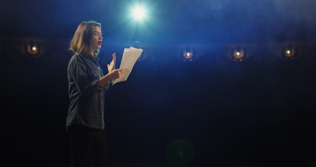 Actress rehearsing in a theatre